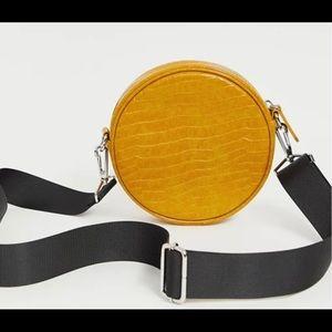 ASOS Monki faux croc round crossbody bag mustard
